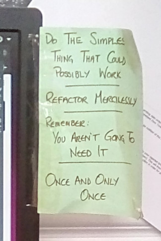 Post-it note reading Do The Simplest Thing That Could Possible Work, Refactor Merciliessly, Remember You Aren't Going To Need It, Once And Only Once