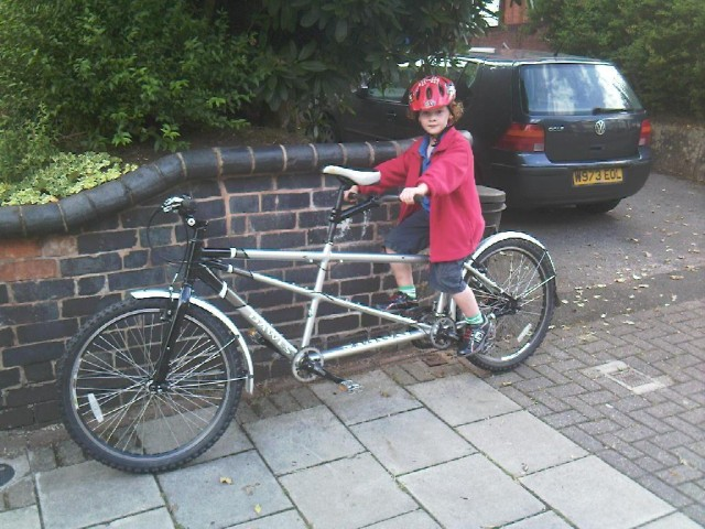 """Harry on tandem, waiting for passer-by to shout """"aren"""